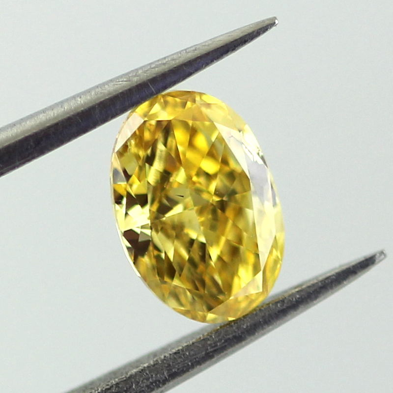 Fancy Vivid Orangy Yellow Diamond, Oval, 0.51 carat