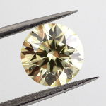 Fancy Yellow, 0.90 carat, SI2