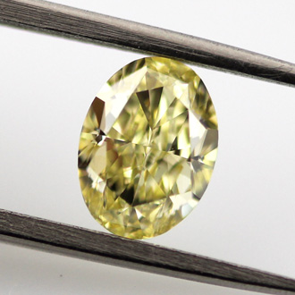Fancy Yellow, 0.90 carat, VS1