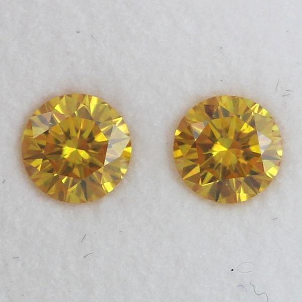 Pair of Fancy Vivid Orangy Yellow Diamond, Round, 0.60 carat, SI2