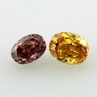 Pair of Vivid Yellow Orange and Deep Orangy Pink, 0.51 carat, SI1