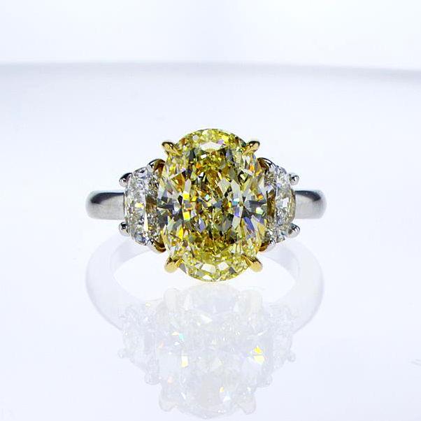 Fancy Light Yellow Diamond Ring, Oval, 5.03 carat, VS2